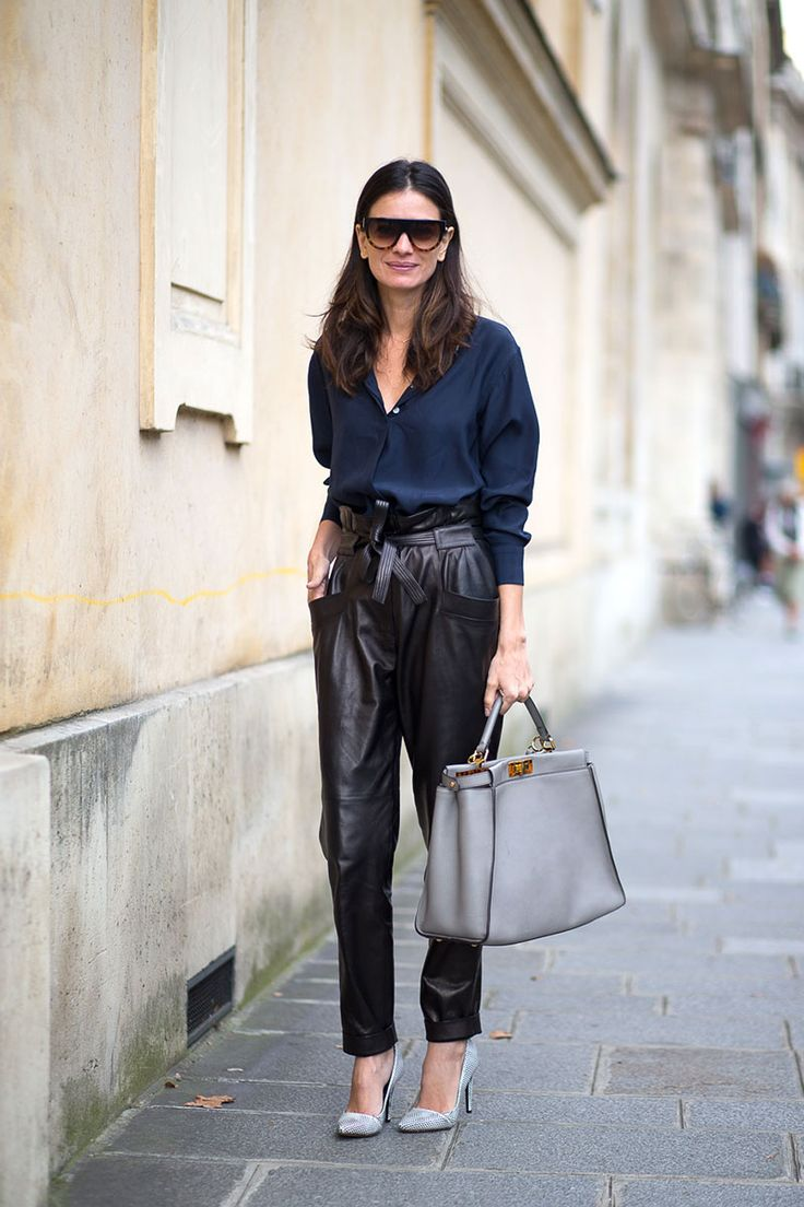 Navy button down + black paperbag tie waist leather trousers + pumps + gray bag: