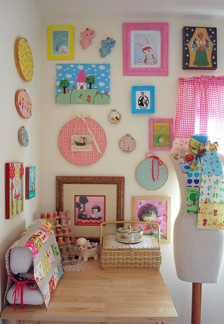 sewing nook (love the cover for the sewing machine and the framed fabric on the wall)