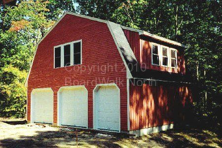 This 3 Car Garage With A Gambrel Roof Style Has A Huge