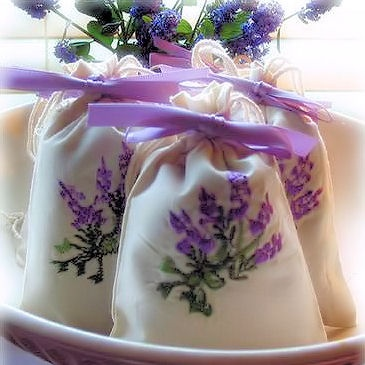"A beautiful sachet for bridal showers and wedding favors. The hand-embroidered, ivory muslin pouch is filled with a generous amount of fresh French lavender and accented with coordinating satin ribbon. Oversized sachet measures 3"" x 5""."