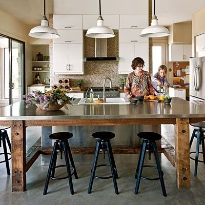 Dana and I really like the wood and stainless steel or zinc top approach with stools around 3 sides and H beam providing footing for stools and a spot for cabinetry on one side if wanted