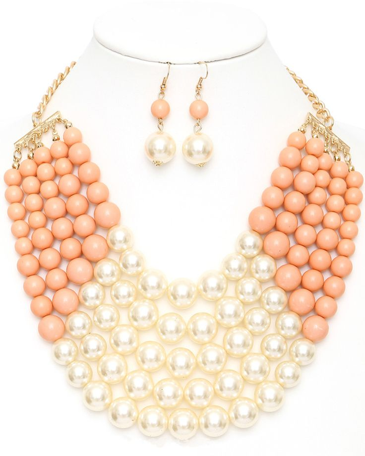 A bold, modern take on the classic pearl necklace. Natalie statement necklace will dress up any outfit. For a fashionable look, match it with a buttoned-up collar shirt, high-waisted skirt and pumps.