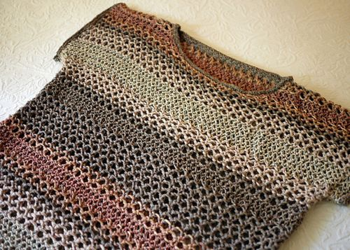 I know it's a crochet pattern, but I love the coloring and you could probably find a similar eyelet knit pattern... hmmm...