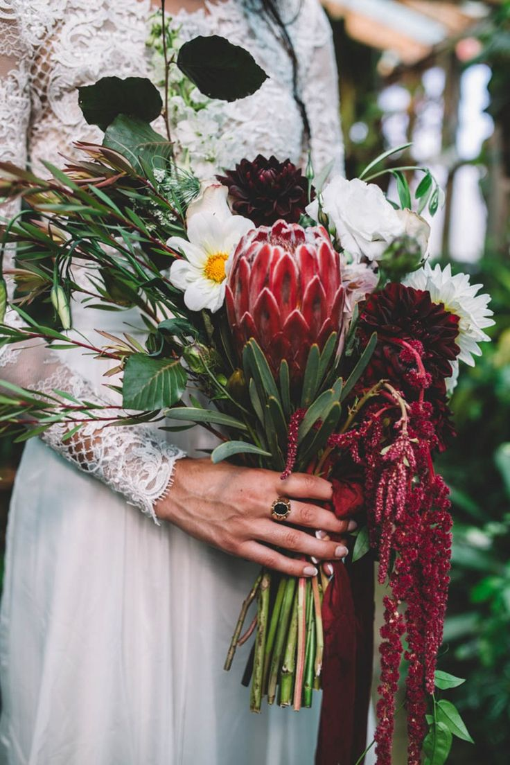 protea and amaranth richly-toned, unstructured wedding bouquet
