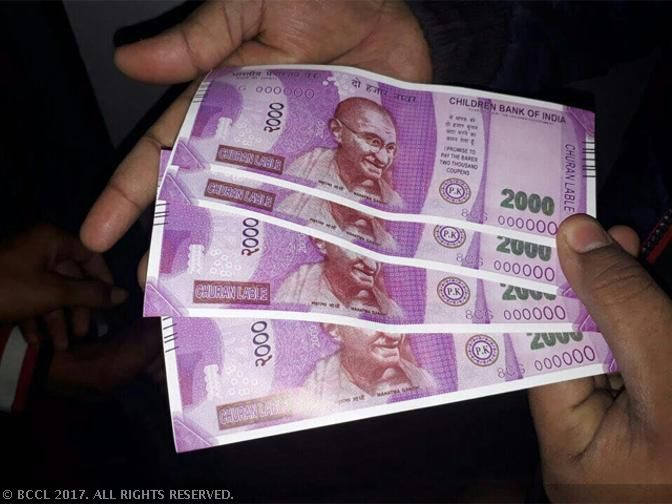 Currency in circulation at two thirds the pre-note ban levels in early November - The Economic Times