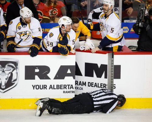 Calgary Flames' Dennis Wideman Checks Linesman to the Ice... #CalgaryFlames: Calgary Flames' Dennis Wideman Checks Linesman… #CalgaryFlames