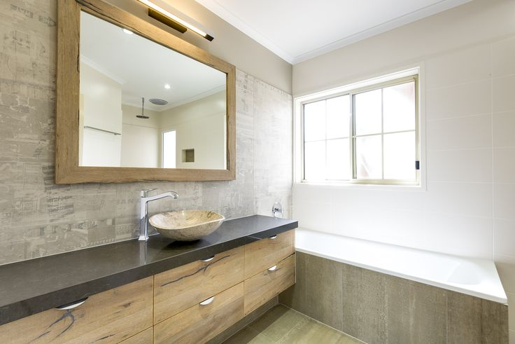 Recycled wild river endeavor white wash floor boards for storage and mirror surround in a Bubbles Bathroom