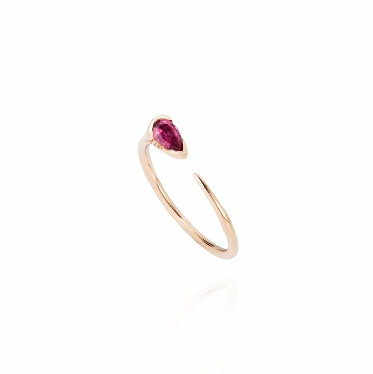 This non-diamond pink minimalist gold band engagement ring is gorgeous.