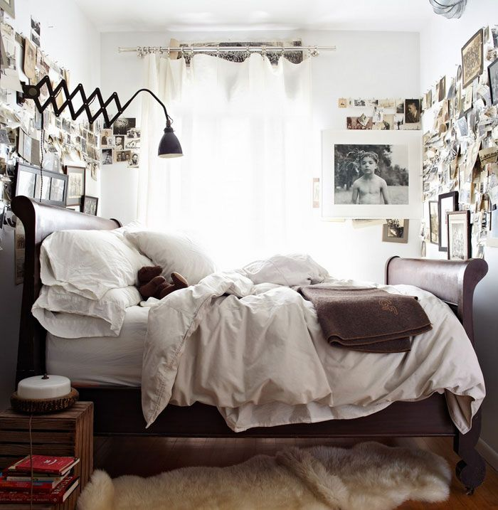Dreamy rustic bedroom, industrial lighting, photo wall, vintage photos, white linen, sleigh bed.