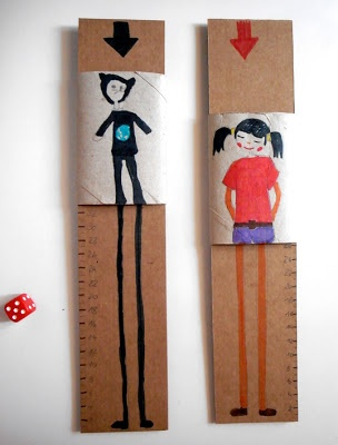 adorable game made from a cardboard tube - throw the dice and see who grows the tallest