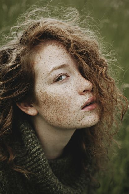 Freckled skin & curly hair: one way nature mutes color and creates texture in humans.