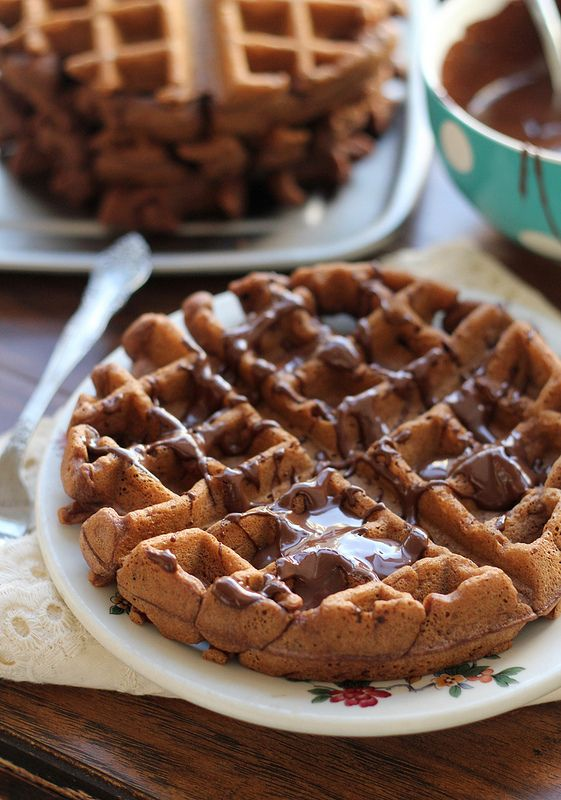 Breakfast gets decadent with these chocolate stout waffles smothered in chocolate-peanut butter syrup.