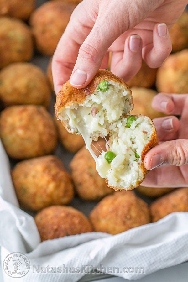 Cheesy Rice Balls (Italian Arancini) Family Approved!  If you've never had Arancini, you're missing out!  They're delicious!