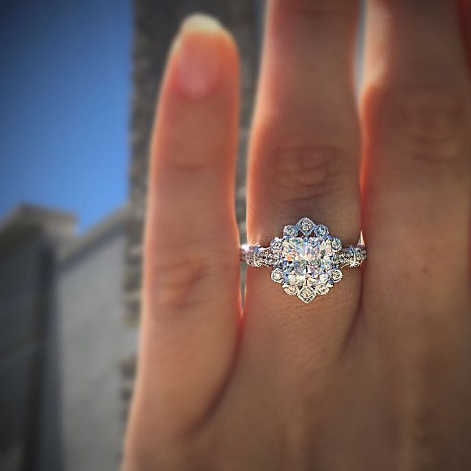 a floral inspired halo engagement ring available at Diamonds by Raymond Lee in 14k white gold. #engagementrings #halorings