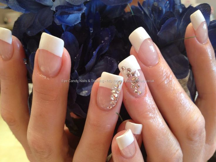 White tips with acrylic overlays and Swarovski crystal ring fingers