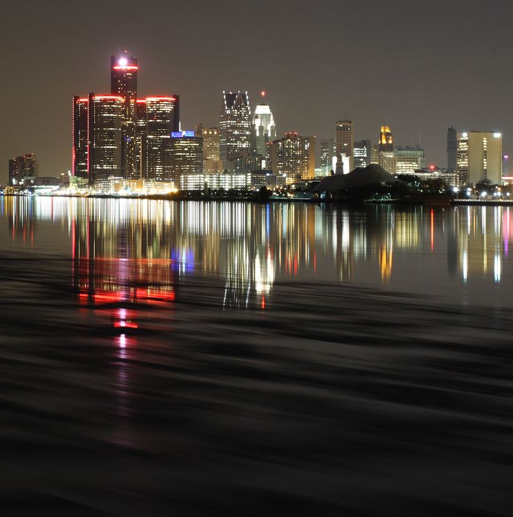 Red Detroit - Nighttime in Detroit, with the Renaissance Center glowing red in honor of the American Red Cross. A slow moving Detroit River provided amazing reflections, and a small shoreline ice flow provided some variety in the water.