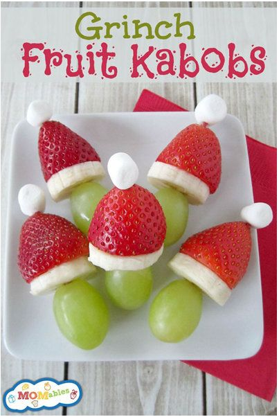 100 Days of Christmas Day 94 - Here's a cute, kid-friendly appetizer for the holidays. Make Grinch Kabobs out of strawberries, grapes, bananas and marshmallows! Momables has the details for you.