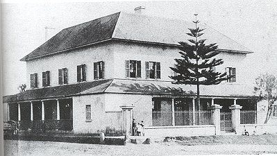 """Macquarie Arms Hotel, Windsor owes its origin directly to Governor Macquarie. In his journal of January 12 1811 he wrote """"I gave Mr Fitzgerald a large allotment in the Square on the express condition of his building immediately thereon a handsome commodious Inn of brick or stone and to be at least two storeys high"""". (photo 1870s)"""