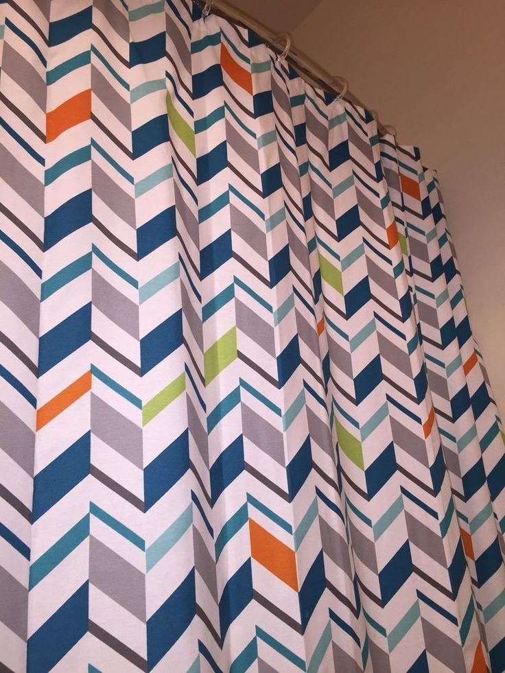 Nice like new shower curtains changing decor. Geometric pint with lime green, orange, grey, cerulean and ocean blue. Plastic rings NOT included, liner not included.