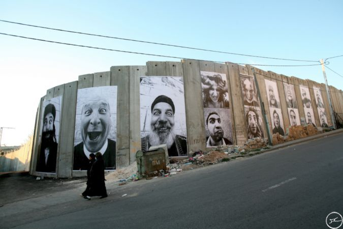 Street artist JR 28 Millimeters, Face2Face  Separation Wall, Palestinian Side In Bethlehem, March 2007