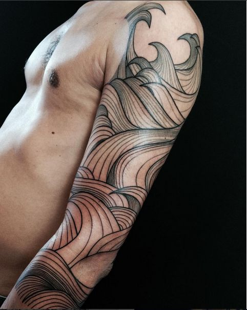 Beautiful linework waves by Belly Button Tattoo Shop.