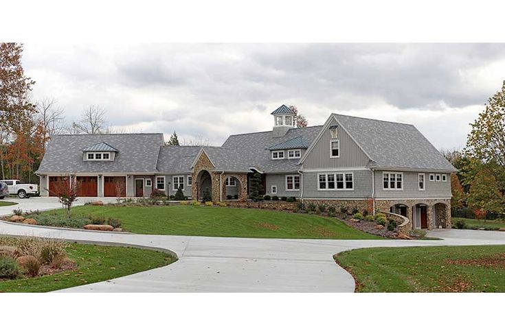 A carriage house shingle gives this custom home some flare.
