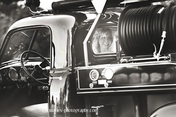 C.Marie's Photography - Bride waiting to go down isle in vintage fire truck.