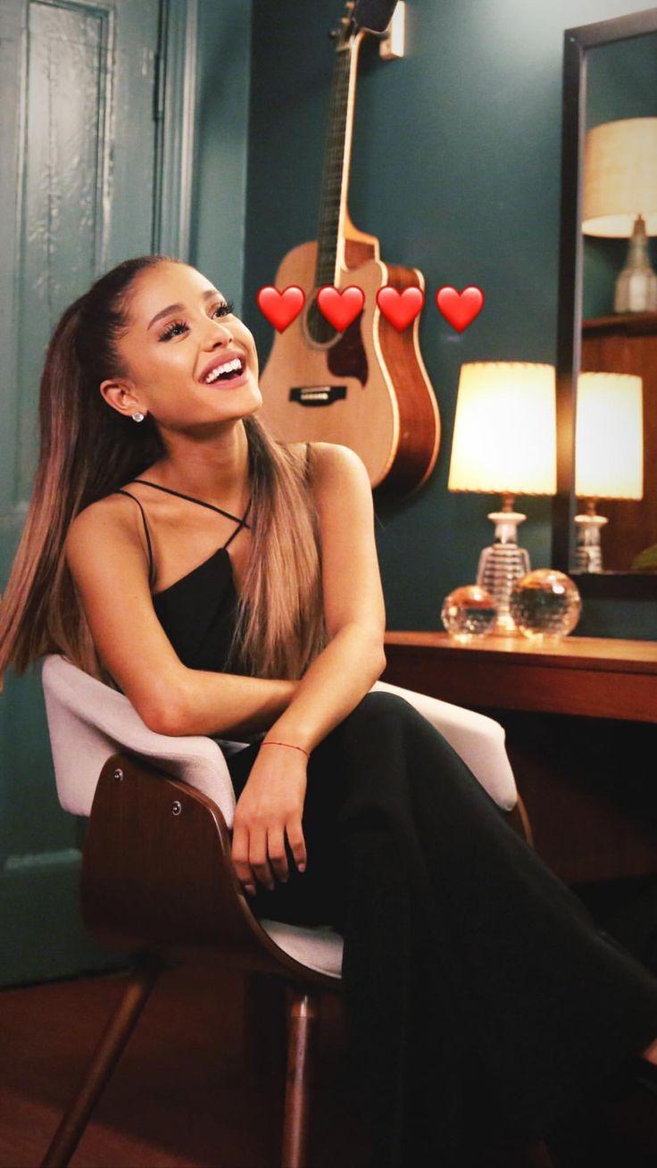 Ariana Grande with red heart emojis around her.:).