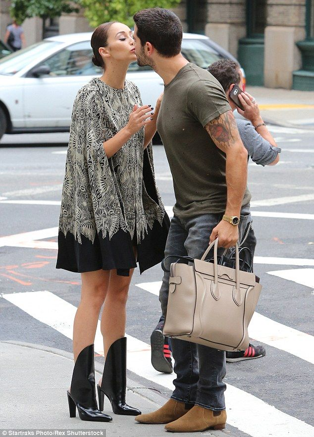 Kisses from her man: Cara's doting boyfriend, Jesse Metcalfe, gave her a peck on the lips as she headed off for a busy day of fashion shows