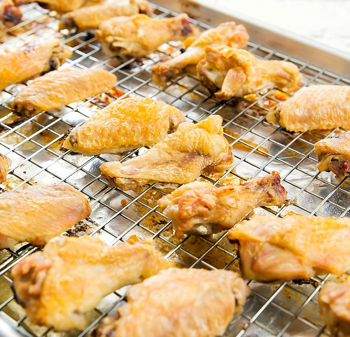 I'm sharing a method for producing the crispiest baked chicken wings. With just one extra ingredient, wings come out golden with skin that stays crispy