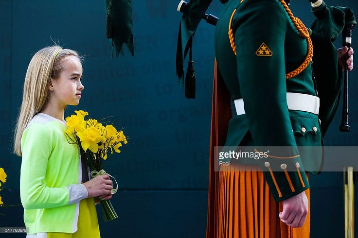 A young girl holds flowers during the Easter Sunday Commemoration Ceremony at the General Post Office on March 27, 2016 in Dublin, Ireland. Today marks the 100th anniversary of the Easter Rising in the Republic of Ireland when in 1916 a rebellion was attempted to oust British rule of the country.