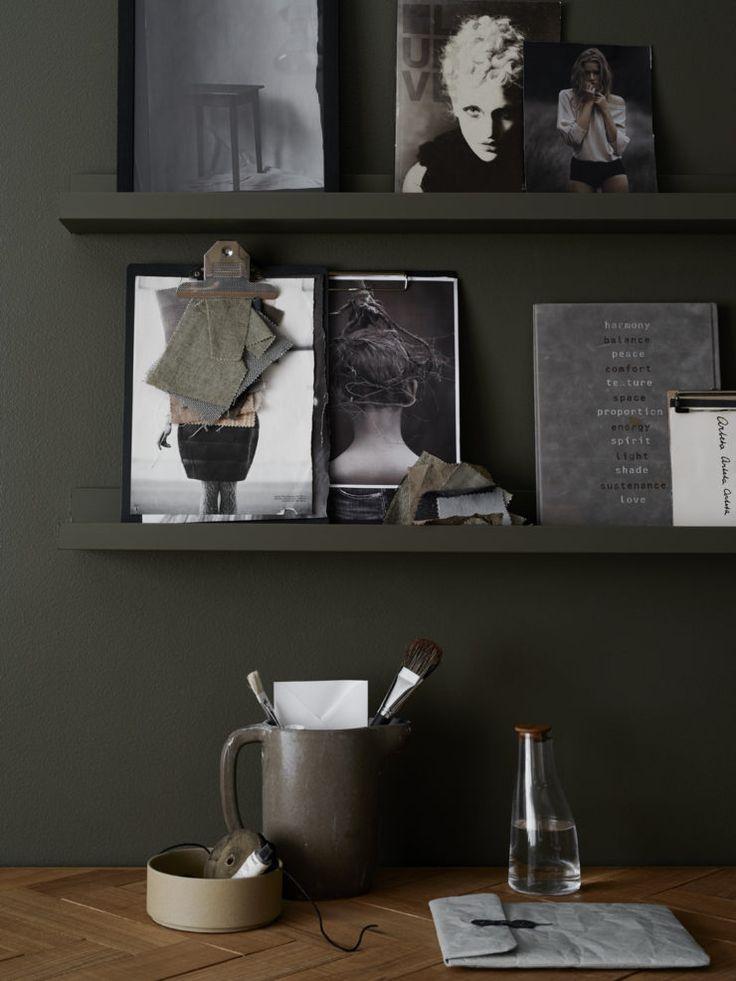 Dark olive green wall, workspace details
