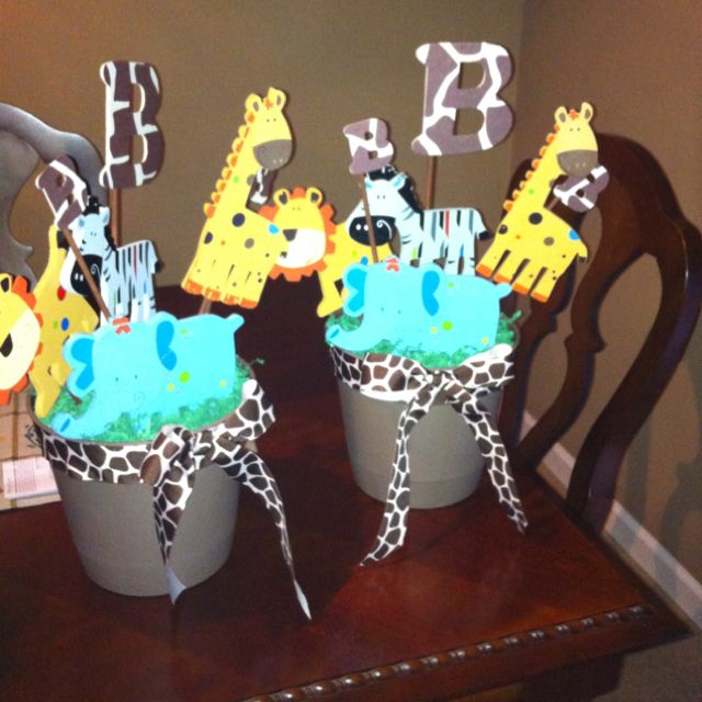 Boy Jungle Theme Baby Shower Centerpieces - use wooden animals from Michael's for $1 each & already painted.