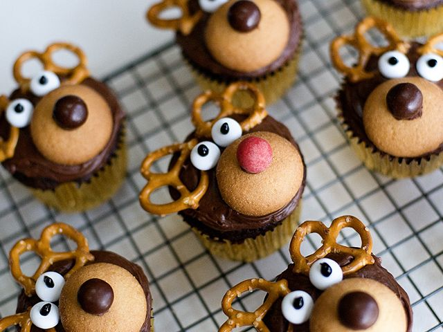 Decorate cupcakes with pretzels and candy to create these tiny reindeer cupcakes.