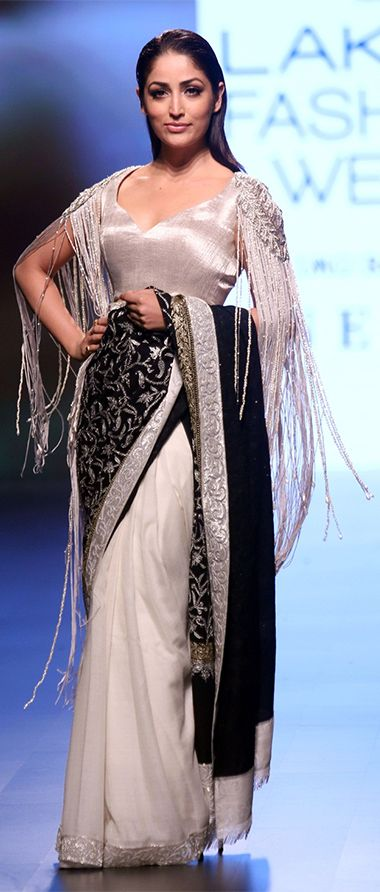 Yami Gautam in an designer ivory sari with a black embellished pallu that was enhanced by a fussy silver blouse at one of LFW 2018 events. (Image Source: Free Press Journal)