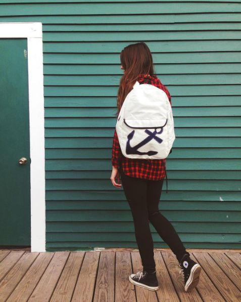 The Sea Bags Navy Anchor Backpack is both a chic and practical accessory.