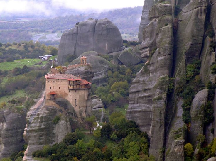 GREECE.....Meteora Monastery....In Meteora, Greece, six magnificent monasteries still exist, precariously perched atop 1,300 feet high sandstone pinnacles. Hermit monks constructed the first monastery before nuns came to build too. Access to each monastery was crazy, a leap of faith, climbing rocks, and ladders lashed together or large nets until the ropes would break.