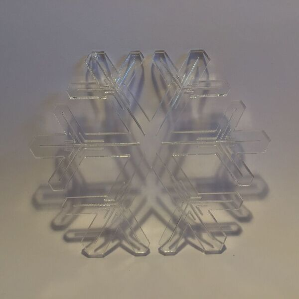 Lasercut acrylic snowflake by Bror David. Designed and produced in Copenhagen.