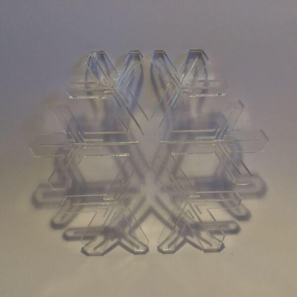 Lasercut acrylic snowflake by Bror David. Designed and produced in Copenhagen.