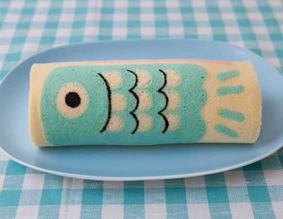 Children's Day Koi Carp Cake Roll    Koi flags fly high on Children's Day in Japan...Koi carp are symbols of strength and determination because they can swim upstream.    From Junko-san of Slightly Clever and Cute Cakes Blog (ちょっとの工夫でかわいいケーキ)