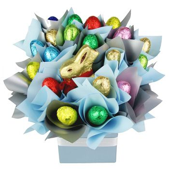 Colors of Easter for delivery to UAE. For spreading spring cheer, nothing beats this creative Easter gift that's sure to catch their eye with lovely ribbons, bows, colors, and - of course - chocolate. Fifteen delicious Easter Eggs are displayed in a pretty bouquet surrounding everyone's favorite - the Gold Lindt Chocolate Bunny - and the whole arrangement is presented in a Ceramic Pot. Bring back the Easter magic to both children and adults by sending this great eggilicious surprise!