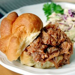 Mouth-watering pork cooked in a slow cooker with beef broth served with barbecue sauce.
