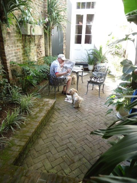 New Orleans courtyard... Brick courtyards on aping afternoons after a rain are great, especially if they are near a sweet olive tree