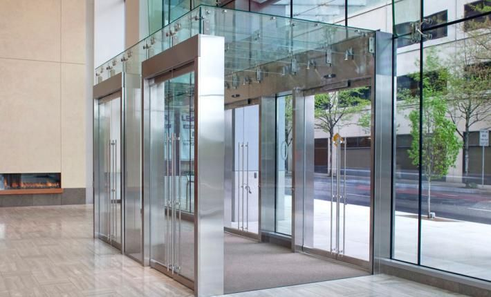 Commercial vestibule design google search lobby design - Residential exterior glass wall panels ...