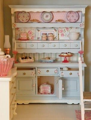 hutch so cute - I like the different paint &/ or wallpaper behind the 3 shelves. It would be pretty to continue that in the drawers & below.