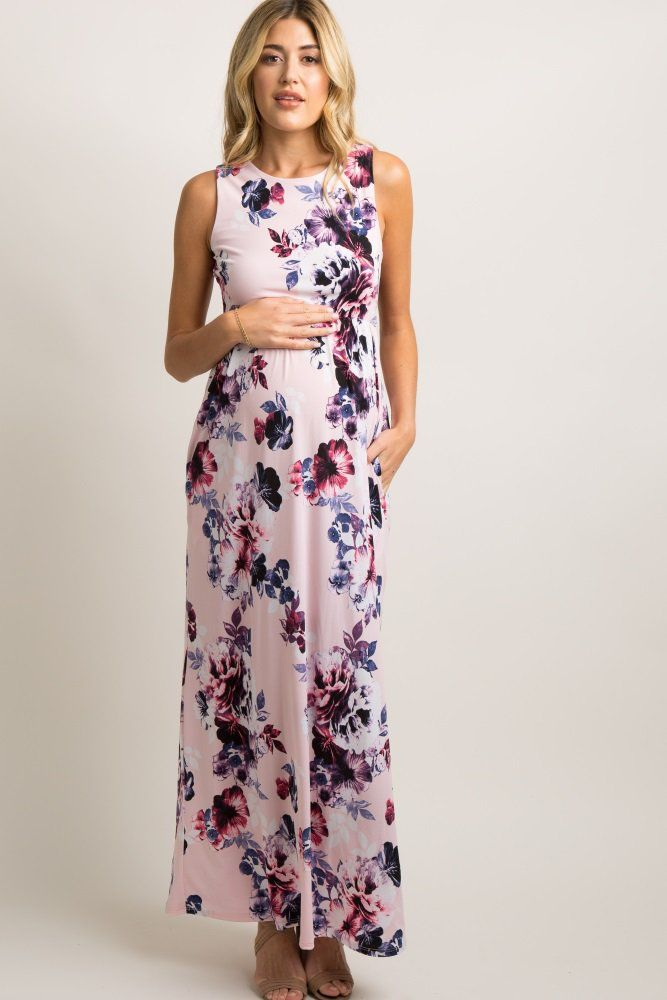 276a2f2487698 Pink Floral Print Sleeveless Maxi Dress A floral print, sleeveless  maternity maxi dress with a cinched elastic waistline, rounded neckline and  side pockets.