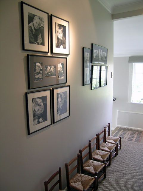 Empty those boxes and hang 'em up to make the hallway an interesting space. Created by Room Service Interiors.