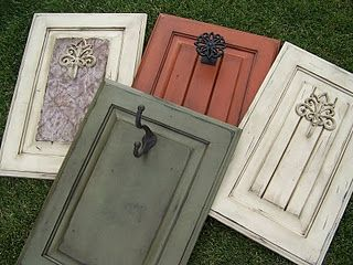 old cabinet doors used as decorations or functionals wall hangers! Love it!