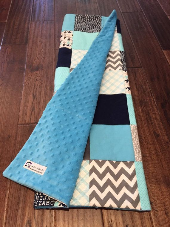 Adorable modern yet classic baby boy quilt. Blue, navy and grey / gray baby quilt.