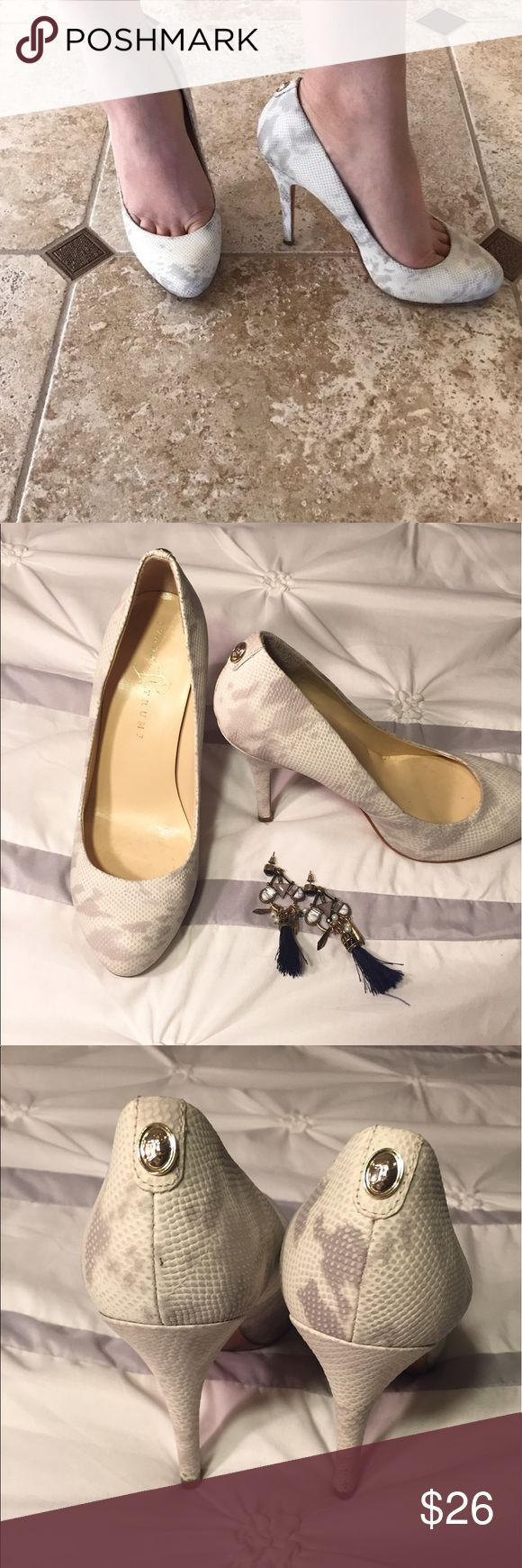 Snakeskin Ivanka Trump heels Gorgeous and in great condition. They were worn twice, and there is wear to the leather soles. Other than that they are in excellent condition. 4 1/2 inch heels Ivanka Trump Shoes Heels